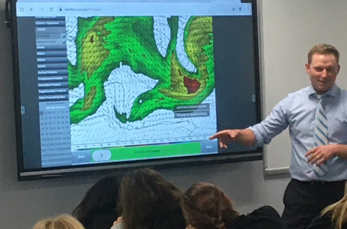 image of Meterologist visit featuring a Meterologist explaining how a weather map works